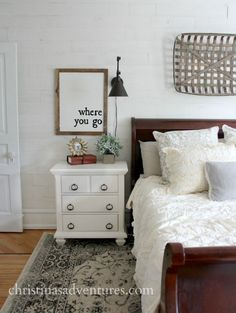 where you go wood sign over the nightstand in this farmhouse bedroom - love the tobacco basket over the bed
