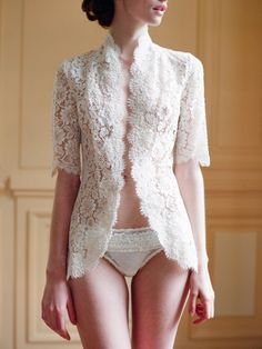 Lace. I love lace. And this looks very much like a kebaya.