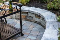 Fine Design Landscaping highlighted this Long Island outdoor living space landscape with hardscaping. This space features Cambridge Stone Veneer.