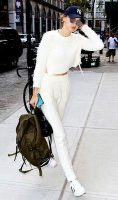 Gigi Hadid looks comfy chic in a fuzzy sweater and knit pants.