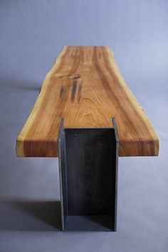 This is a custom item. Please inquire before purchasing to discuss options / dimensions. A repurposed beam, from a local Portland warehouse floats between two hunks of steel H beam that are 10 inches square and 42 pounds per foot (hence the name '10x42'). Subtle detailing exposes the