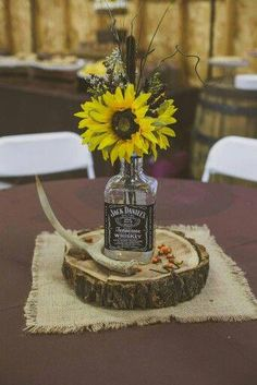 Whiskey Bottle centerpiece Rustic Wedding Decor (minus the deer antler) Bottle Centerpieces, Wedding Table Centerpieces, Rustic Sunflower Centerpieces, Centerpiece Flowers, Antler Centerpiece, Country Wedding Decorations, Centerpiece Ideas, Fall Wedding, Our Wedding