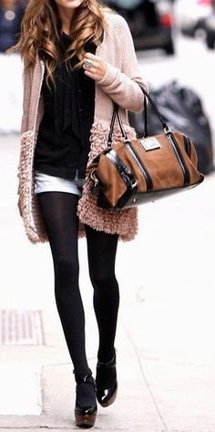pink ruffle cardi w/ black tights and black platforms
