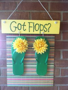 summer sign made with painted board, bamboo placemat & flip flops