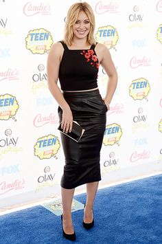 Hilary Duff wore a black crop top with red floral embroidery and a midi leather skirt to the 2014 Teen Choice Awards.