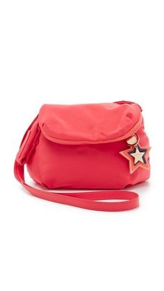 Optional star charms hang from the front of this slouchy See by Chloé cross-body bag. Magnetic top flap with zip pocket. Lined, 3-pocket interior. Adjustable shoulder strap. Dust bag included.