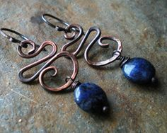 Copper and Dark Blue Lapis Swirl Earrings Thick copper is hand formed, hammered for texture and accented with dark blue lapis beads. Total length from the top on the ear...