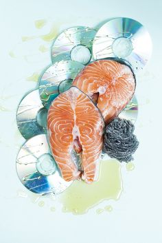 """Stephanie Gonot has the best textures in her photographs. stephaniegonot: """" Salmon steaks over CDs, for Redmilk Magazine """" Still Life Photography, Art Photography, Product Photography, Pop Art, Milk Magazine, Fashion Still Life, Street Art, Wall Street, Composition Art"""