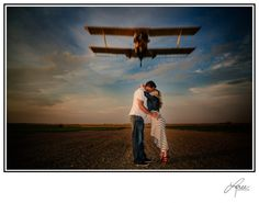 Loved how I had my husband fly our plane over this newly engaged couple for their photo session. www.loreephotography.com