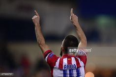 Atletico Madrid's Turkish midfielder Arda Turan celebrates after scoring their second goal during the UEFA Champions League quarterfinal second leg...