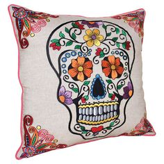 Add a pop of pattern to your sofa or loveseat with this chic pillow, showcasing an embroidered sugar skull motif for eye-catching appeal.  ...