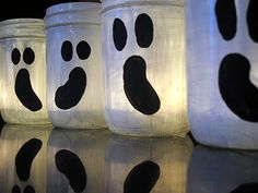 Ghost luminaries...paint empty jars with white acrylic paint, when dry draw ghost eyes and mouth with black sharpie and fill in with black acrylic paint...add candles and poof!