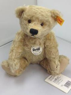 Steiff Bear Classic 1920 Teddy Bear Blond 000645   Traditional Steiff   Steiff Classic 1920 Teddy Bear Made From Light Blond Mohair. Fully Jointed With Hand Embroidered Black Nose And Mouth. His Eyes Are Brown With Black Pupils And He Has Felt Paws. A Delightful Bear With An Appealing Face. Surface Washable.   Yellow Label With Famous Steiff Button In The Ear.