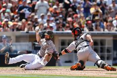 San Francisco Giants catcher Buster Posey, right, makes a swipe tag to San Diego Padres' Xavier Nady, who is out trying to score from first on a bases-loaded double hit by Chase Headley in the third inning of a baseball game on Sunday, April 20, 2014, in San Diego. Nady was ...