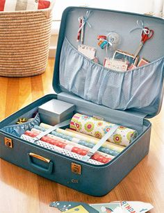 Organize your wrapping paper, ribbons, scissors and more in an old suitcase!