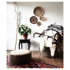 Bamboo swivel rocker and ottoman with two pillows and original ottoman cushion. $200  Black side table $55  Wool runner or wall hanging $72  SOLD Blanket on chair  Baskets $12-35