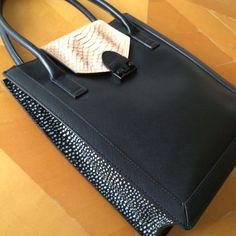 Loeffler Randall snake & black leather work tote Really gorgeous leather bag with what looks like hand painted panels on each side. Snake print flap closes with a metal clasp. Very durable and in new condition with no flaws, marks or stains. I bought this before realizing that it doesn't suit my lifestyle. Dust bag not included. Price is firm. Loeffler Randall Bags Totes