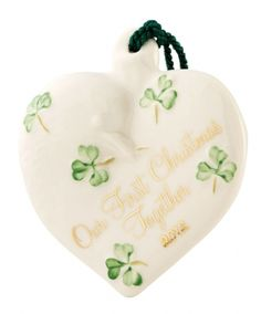 """Spread a little joy during the festive season with beautiful handcrafted Irish Christmas ornaments from Belleek. The Our First Christmas Together 2012 Ornament is handcrafted in Ireland of fine Parian China. 3.25""""L x 3.25""""W x 3""""H."""