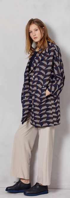 For an office-look that's deceptively warm, go for a geometric print overcoat that passes for a long blazer over a sleek-yet-comfortable pair of wide slacks from Bogner Woman.
