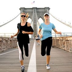 Heidi Klum and Brooklyn Decker running over the Brooklyn Bridge