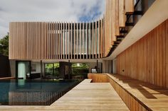 Architecture, Delightful Kooyong Residence Located In Melbourne By Matt Gibson Architecture Featuring Wood Paneled Exterior Wall Deck With Awesome Swimming Pool And Greenery: Stunning Curved House Designs with Wood Elements