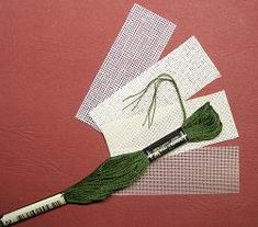 What kind of fabrics and threads are are used in dollhouse needlepoint kits