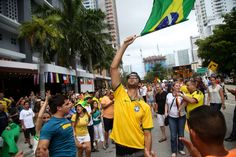 Lucas Fraga, 24, waved a flag in the Brickell area of Miami after Brazil's victory over Colombia in the World Cup this month.