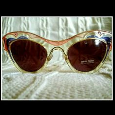 NEW Miu Miu Sunglasses Retro inspired MIU MIU sunglasses, Brand New!   These sunnies are a great addition to any spring/summer wardrobe!   *Clear/pink/purple color scheme with a hint of yellow on the arms *Scalloped design across the brow  *Open heart design around the corners of the lenses *Signature MIU MIU stamp on both arms   Original retail price: $300 Miu Miu Accessories Sunglasses