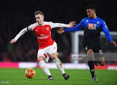 Calum Chambers of Arsenal and Joshua King of Bournemouth compete for the ball during the Barclays Premier League match between Arsenal and A.F.C. Bournemouth at Emirates Stadium on December 28, 2015 in London, England.