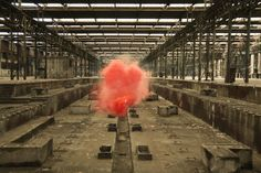 Italian artist Filippo Minelli became fascinated with smokebombs after viewing them in use during various political protests. Keeping that in mind, the artist chose to photograph many of these smokebombs in a rather unusual setting. Instead of seeing these immense color saturated plumes of smoke arising from the chaotic scenes of a protest, the artist chose to photograph them in a different element entirely.