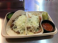 ... beef tacos cooked in Tinga sauce on a flour tortilla located in