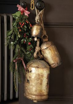 greenery and rustic bells on door for christmas