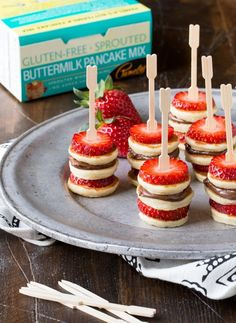 Need brunch recipes? These make ahead Gluten-Free Mini Pancake Skewers couldn… Need brunch recipes? These make ahead Gluten-Free Mini Pancake Skewers couldn't be simpler and they look adorable on the buffet table. Pamela's Gluten Free Sprouted Pancak Köstliche Desserts, Dessert Recipes, Pancake Recipes, Party Recipes, Bacon Pancake, Buffet Recipes, Birthday Recipes, Allrecipes Desserts, Holiday Recipes