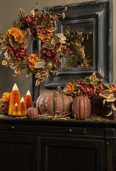 Beautiful display of fall colors and foliage. The candy corn colored trees are a bright pop of color against the faded fall colors. Harvest Decorations, Thanksgiving Decorations, Thanksgiving Ideas, Craft Decorations, Manualidades Halloween, Autumn Decorating, Primitive Fall Decorating, Fall Arrangements, Fall Table