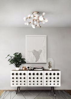 Mid-century design: Mid-century chandeliers that will elevate your mid-century modern interior! White gives your room a wonderful calmness ...  and this fancy commode comes in gold !!! More inspiration at ARTEIOS Concept Store in Baden-Baden https://www.arteios.com  #interior #interiordesign #myinterior #furniture #homedesign #colors #trends #inspirationalideas #lighting #delightfull #arteios #baden-baden #cosmopolitan #contemporary #germany