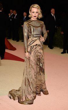 2016 Met Gala: Rachel McAdams is exquisite in a beige sequin Valentino long sleeve gown with a beautiful design. Rachel mixes glam and edge in her Met Gala look.
