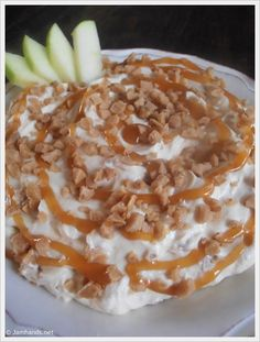 Caramel and Toffee Apple Dip  Makes about 3 cups  1 (8 oz.) pkg. cream cheese, softened  1 (8 oz.) pkg. frozen nondairy whipped topping, thawed  1 cup caramel ice cream topping  1 (8 oz.) pkg. toffee bits  Red Delicious and Granny Smith apples, cored and sliced
