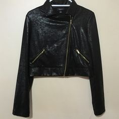 Long sleeve  Moto jacket. Shiny black with gold zippers at pocket and asymmetrical zipper closure. Izbyer Jackets & Coats