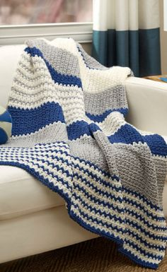 Perfect for sports fans, this Athleisure Striped Throw can be customized to feature your favorite team's colors. If you're not a sports fan, this free crochet throw pattern is just as customizable. The sensible but interesting stripe pattern is nice. Crochet Afghans, Crochet Throw Pattern, Crochet Yarn, Free Crochet, Crochet Blankets, Crochet Stitches, Crochet Hooks, Reverse Single Crochet, Half Double Crochet