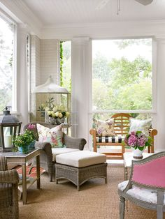 """""""I suggest everyone find a way to have a porch,"""" says homeowner and designer Lillian August. """"It really changes your lifestyle."""" - Traditional Home®  Photo: Emily Followill Design: Lillian August"""