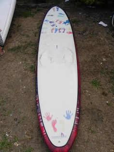 The mini board created for Christopher's Haven and signed by all the 2010 paddlers!