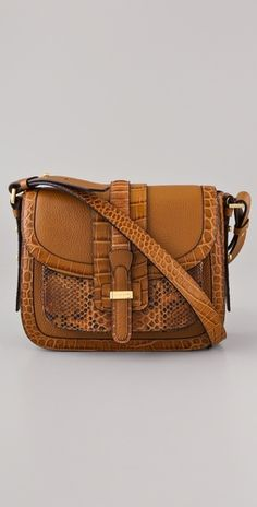 Don't usually love brown handbags, but love this mixed media style from Michael Kors