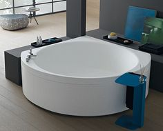 This stunning space saving bathtub is a product of Albatross. It is characteristic in its rounded interior features, 9 cms wide edge and accommodations for keeping bath products as well. Its velvet feel is the most striking feature of the same. Another notable feature of this bathtub is the soft touch control panel that comprises of a lymph drainage mode for providing you with an invigorating massage while bathing. It has a dimension of 140 cm x 140 x x 56.5 cm.