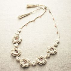 crocheted necklace                                                       …                                                                                                                                                                                 More