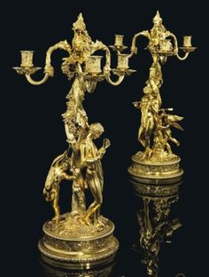 AN IMPORTANT PAIR OF GEORGE IV SILVER-GILT THREE-LIGHT CANDELABRA MARK OF PHILIP RUNDELL, LONDON, 1820, RETAILED BY RUNDELL, BRIDGE AND RUNDELL, BASED ON THE DESIGNS OF JOHN FLAXMAN, MODELLED BY EDWARD HODGES BAILY Price realised GBP 271,250