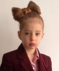 This darling hairstyle was deemed inappropriate, along with braided hair, at her school. Insanity! https://shine.yahoo.com/parenting/little-girls-big-bow-banned-4-old-hairstyle-220000255.html