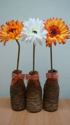 Twine wrapped bottles for vases.  Cute!