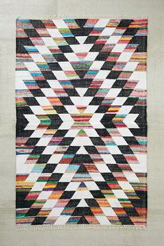 Love this but do not love $429... Urban Outfitters Woven Diamond Kilim Rag Rug