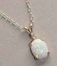 Opal & CZ NecklaceOpal Gemstone Pendant by Opal Gemstone, Gemstone Jewelry, Unique Jewelry, Jewelry Box, Opal Necklace, Pendant Necklace, October Birth Stone, Opal Rings, Necklace Designs