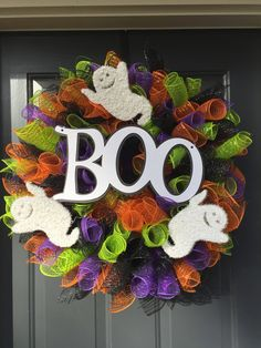"This one of a kind wreath is made of purple, black, orange, and apple green deco mesh tubes. In the center is a white wooden with glitter ""Boo"" sign. This wreath has been accented with white glittery ghosts! Each ghost measures 4 inches tall. Halloween Door Wreaths, Halloween Door Decorations, Halloween Trees, Holidays Halloween, Halloween Crafts, Halloween Stuff, Unicorn Halloween, Halloween Makeup, Halloween Costumes"